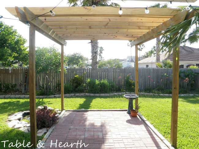 Save thousands by building your own DIY pergola with this simple design and tutorial from Table & Hearth!