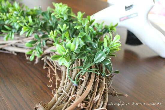 This is such a quick, easy, and cheap tutorial for making you own DIY Boxwood Wreath!