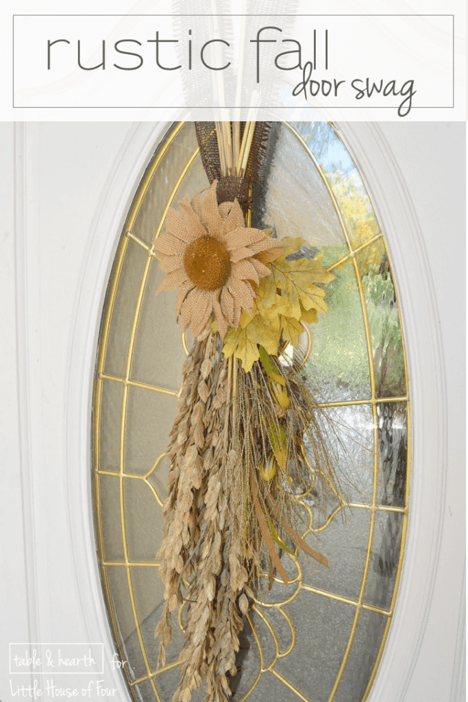 So easy and cute! A few strands of grass, some fall leaves, and burlap ribbon make this super cute fall door swag!