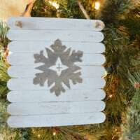 Rustic Planked Snowflake Ornament - This easy to make and customize ornament brings a sparkly rustic touch to your tree