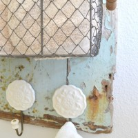 Trash to treasure!! You can make all kinds of found stuff useful! Table & Hearth took this little wooden door from the beach and made it into an adorable rustic towel organizer for the bathroom. So cute!! www.tableandhearth.com