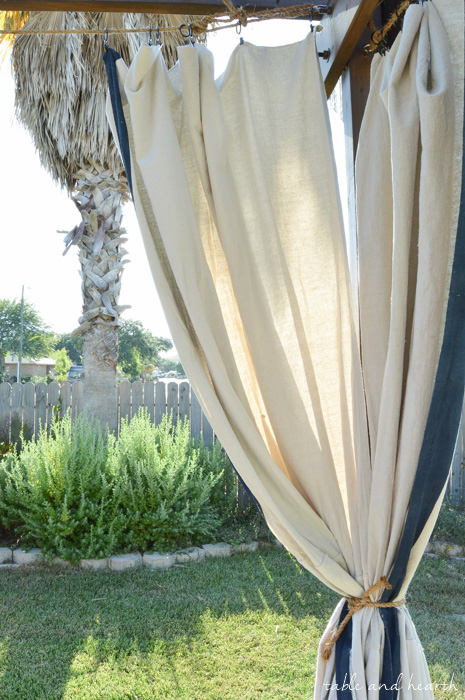 High Style, Low Budget - Bring elegance and luxury to your outdoor space without spending a fortune by making these DIY No-Sew Outdoor Curtains! www.tableandhearth.com