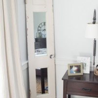 Love it! She took an old chippy paint door and transformed it into a full length mirror!