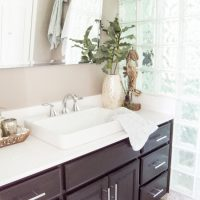 A few glamorous and coastal-inspired pieces from the Pier 1 bath collection easily transformed this master bathroom to a coastal oasis! www.tableandhearth.com