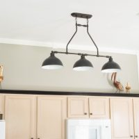 Updating overhead kitchen lighting to these beautiful black farmhouse pendant lights from Jeremiah lighting! www.tableandhearth.com