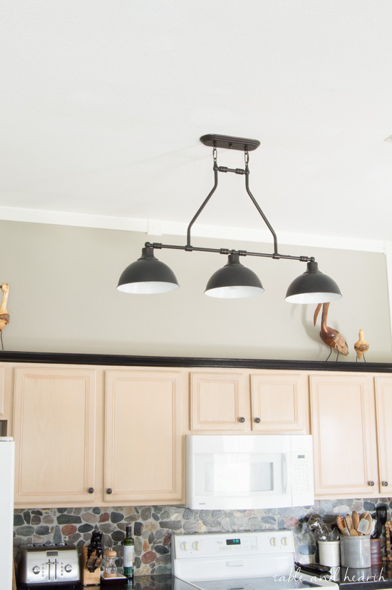 overhead kitchen lighting. updating overhead kitchen lighting to these beautiful black farmhouse pendant lights from jeremiah www