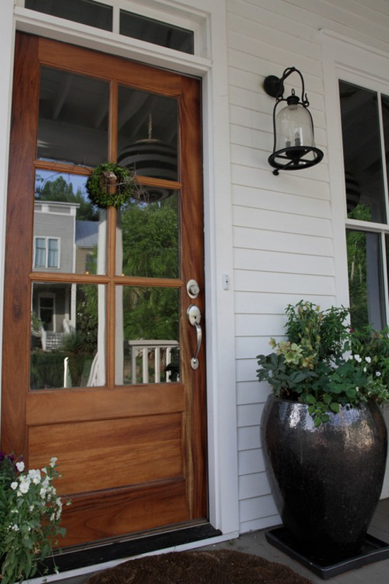 20 beautifully classic farmhouse stained wood doors for Farm door ideas