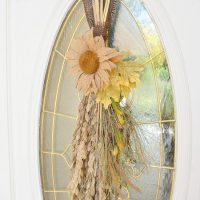 Love this rustic fall door swag with burlap and beautiful coastal grasses!