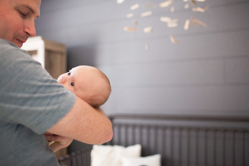 Beautiful family lifestyle photo shoot for a newborn in the nursery