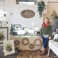 Amazing rustic white art booth for a holiday market!