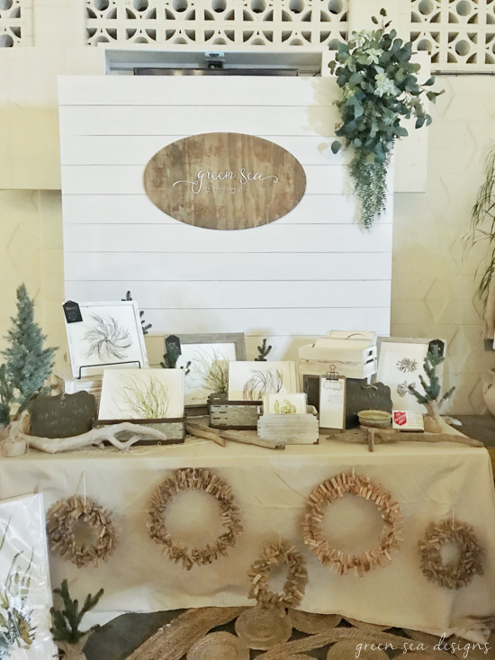 Farmhouse charm for a booth! DIY shiplap backdrop for a vendor booth or craft show! Tutorial at www.tableandhearth.com